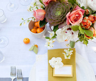 Colorful yellow, pink, orange and green centerpieces