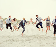 Jumping bridal party and friends portrait