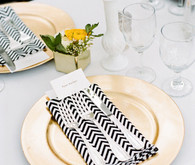 Gold plates and chevron napkins