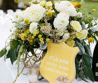 Yellow floral arrangements and sign