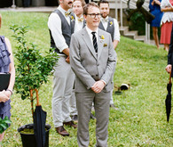Groom standing on chevron rug