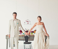 Ivory bride and groom attire