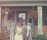Groom and bride portrait in front of house