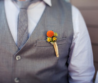 Gray Tie and Vest with Orange Boutonniere
