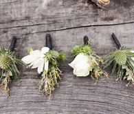 ivory and green boutonnieres