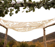 lace fabric and greenery chuppah
