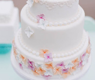 Delicate Purple and Orange Flower Cake