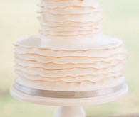 delicate two-tiered cake with simple rose topper