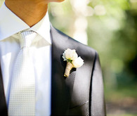 Elegant White Checkered Tie and Rose Boutonniere