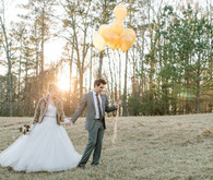 gold balloons winter wedding portrait