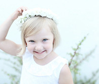 white flower girl dress and floral crown