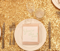 gold sparkly linen and pink napkin