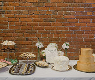 Vintage Glam Dessert Table with Exposed Brick Wall