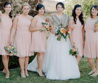 Bridesmaid in light pink dresses