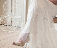 White shoes and sequin wedding dress