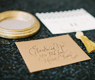 Black and gold escort cards