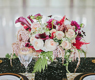 Light pink and maroon floral centerpiece