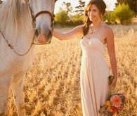 Bride with horse in a field