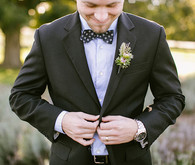 Black and purple tux with polka dot bow tie
