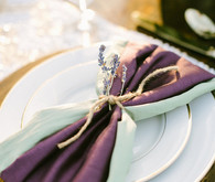 Purple and mint napkin tied with twine and lavender