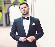 Groom in tux with bow tie