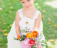 Flower girl with small colorful bouquet