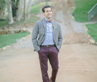 Groom in maroon pants