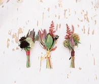 Deep colored boutonnieres