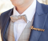 Blue suit with brown bow tie