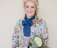 Bridesmaid in colorful dress with blue scarf