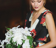 Dutch wedding bride with floral dress and white daisy bouquet