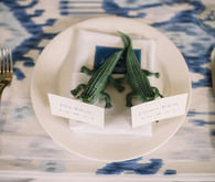 Blue and white place setting with crocodile escort card