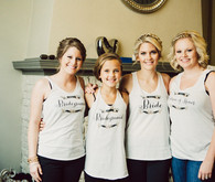 Bridesmaids getting ready with custom shirts