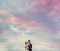 Rainbow sky wedding portrait