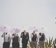 Groomsmen with pink umbrellas