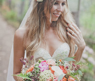 Colorful bohemian bride with flower crown