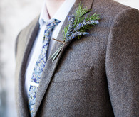Grey suit with lavender boutonniere