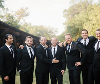 Groomsmen in black suits