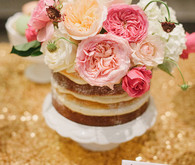 Naked cake with pink peony cake topper