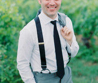 Groom with black suspenders