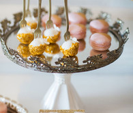 Vanilla dipped cake pops and pink macarons