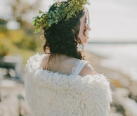 Fall Coastal Bride with fur vest and yellow flower crown