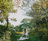 Golden Fall coastal wedding portrait