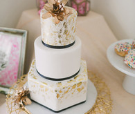 Modern Valentine's Day white and gold wedding cake
