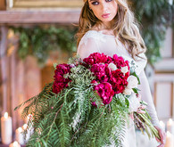 Elegant bride with red and green bouquet