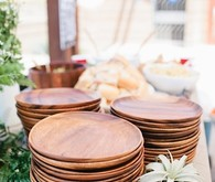 Wood plates on buffet