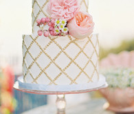 White, pink and gold wedding cake