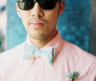 Pink shirt with blue bow tie