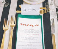 Aqua, black and white striped place setting and menu