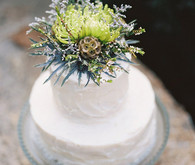Cake with green floral topper